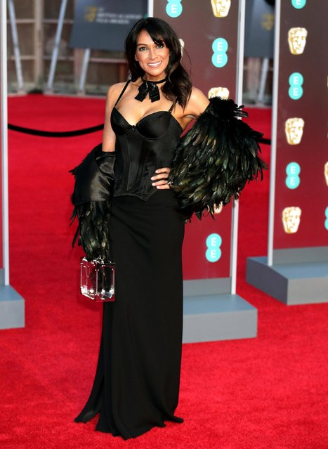 Jackie St Clair poses on the red carpet upon arrival at the BAFTA British Academy Film Awards at the Royal Albert Hall in London on February 18, 2018. (Photo by PA Wire)