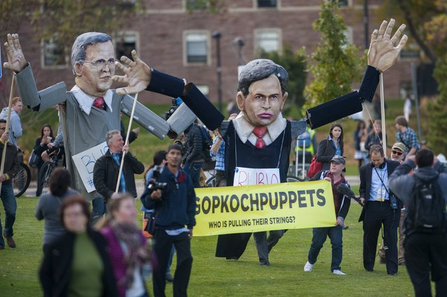 """Students and protesters hold puppets of U.S. Republican presidential candidates Jeb Bush (L) and Marco Rubio as they gather at the """"Free Speech Zone,"""" located at the University of Colorado's Business Field, while candidates gather across the street for a forum held by CNBC before the U.S. Republican presidential candidates debate in Boulder, Colorado, October 28, 2015. (Photo by Evan Semon/Reuters)"""
