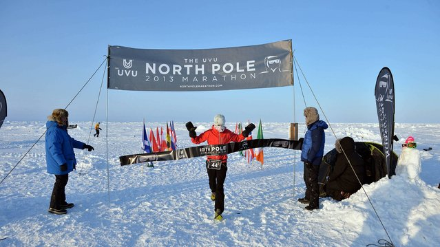 Handout photo of Gary Thornton, winning The UVU 2013 North Pole Marathon, on  April 11, 2013. Known as the world's coolest marathon, the marathon took place just after midnight on April 9th. The 42.195km event was won by Mr. Thornton in a time of 3 hrs 49 minutes. Fiona Oakes, Great Britain, won the female division. Competitors experienced continual daylight at the geographic North Pole and ran a very challenging course in soft snow. Armed guards kept watch for polar bears. (Photo by Mike King/PA Wire)