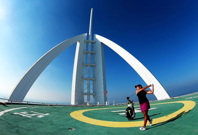 Cheyenne Woods of the USA poses for a picture on the heli-pad on top of the Burj Al Arab Hotel after her second round of the Omega Dubai Ladies Masters on the Majlis Course at the Emirates Golf Club on December 11, 2014 in Dubai, United Arab Emirates. (Photo by Warren Little/Getty Images)