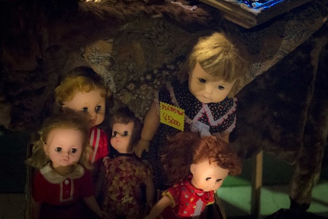 Vintage dolls are for sale at a stall at Boroichi flea market in Tokyo December 15, 2014. (Photo by Thomas Peter/Reuters)