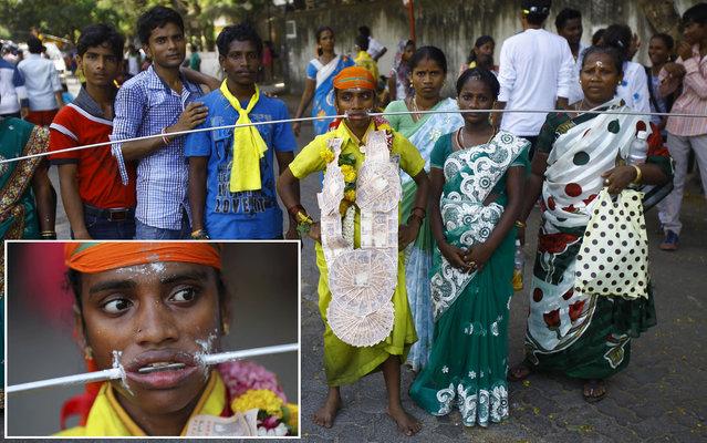 A Hindu devotee has his body pierced during a Hindu festival in Mumbai on 25th April 2013. (Photo by Rafiq Maqbool/AP Photo)