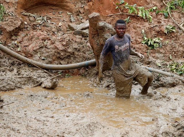 A young man works at Makala gold mine camp near the town of Mongbwalu in Ituri province, eastern Democratic Republic of Congo on April 7, 2018. (Photo by Goran Tomasevic/Reuters)