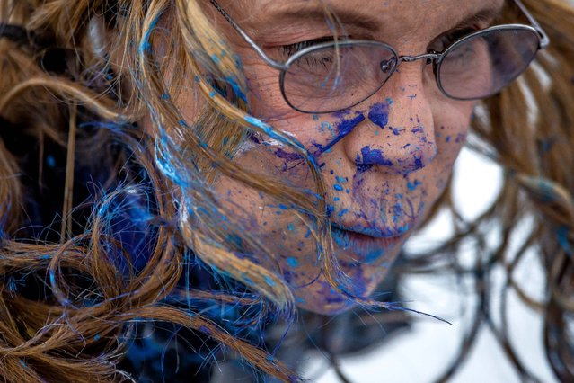 Von Anhalt's face bears the paint splatter from her jet wash painting technique. (Photo by Thomas Cordy/The Palm Beach Post)
