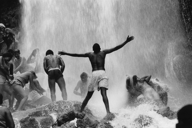 Seau d'Eau, Haiti, 2000. Pilgrims bathe in a waterfall they consider sacred. With medicinal herbs and perfumes, they ask their Voodoo loas – personal or family spirits – to fortify them. (Photo by Abbas Attar/Magnum Photos)
