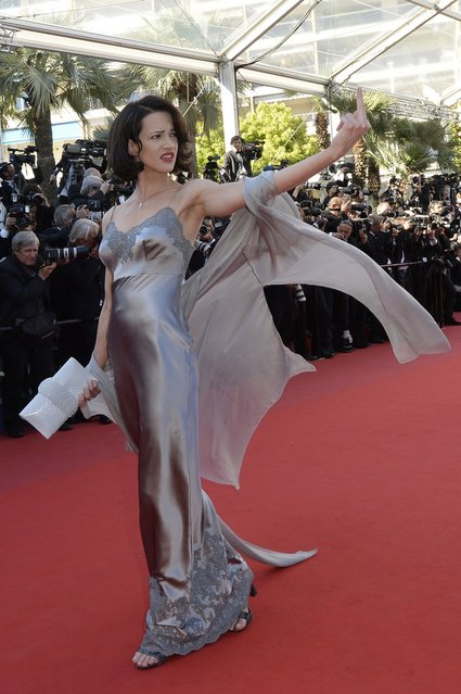 """Italian actress Asia Argento gestures on May 26, 2013 as she arrives for the screening of the film """"Zulu"""" presented Out of Competition at the 66th edition of the Cannes Film Festival in Cannes. (Photo by Anne-Christine Poujoulat/AFP Photo)"""