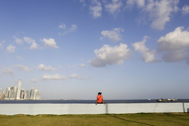 A woman enjoys the view at the sea front in Panama City January 6, 2015. (Photo by Carlos Jasso/Reuters)