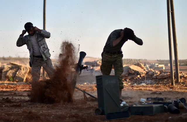 Free Syrian Army members attack Daesh positions at Mari district in Aleppo, Syria on October 27, 2016. The villages were cleared as part of Turkeys Operation Euphrates Shield. The anti-Daesh operation called 'Euphrates Shield', which was launched on August 24, aims at improving security, supporting coalition forces, supporting Syrias territorial integrity and eliminating the terror threat along Turkeys border through Free Syrian Army (FSA) fighters backed by Turkish armor, artillery, tanks and jets. (Photo by Huseyin Nasir/Anadolu Agency/Getty Images)