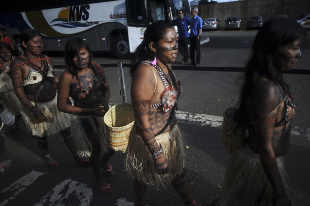 Munduruku Indians arrive at Planalto Palace after being transported from the Amazon region to Brasilia for talks with the government, in Brasilia June 4, 2013. Air Force planes flew 144 Munduruku Indians to Brasilia for talks to end a week-long occupation of the controversial Belo Monte dam on the Xingu River, a huge project aimed at feeding Brazil's fast-growing demand for electricity. (Photo by Ueslei Marcelino/Reuters)