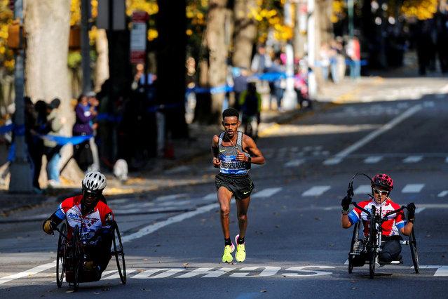 Ghirmay Ghebreslassie (C) of Eritrea leads the men's pack during the 2016 New York City Marathon in the Manhattan borough of New York City, NY, U.S. November 6, 2016. (Photo by Eduardo Munoz/Reuters)