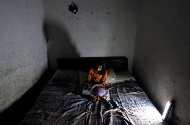 A girl studies during a power cut in Islamabad, Pakistan October 8,  2016. (Photo by Caren Firouz/Reuters)