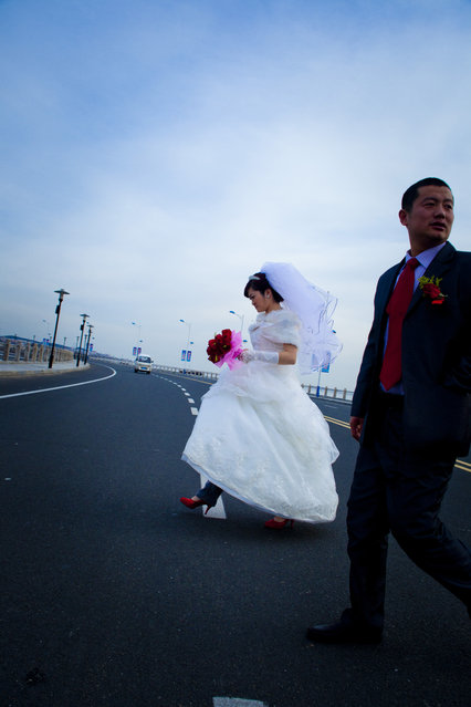 """Bride Crossing"". Newlyweds cross the street to get to their reception. You have to move fast with everything in China. (Photo and caption by Jeffery Boggan/National Geographic Traveler Photo Contest)"