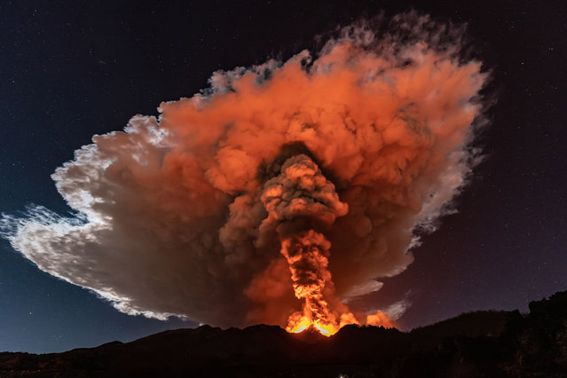 A violent eruption spews ash more than a kilometer into the sky above Mount Etna in Sicily on February 23, 2021. (Photo by Marco Restivo/Barcroft Studios via Getty Images)
