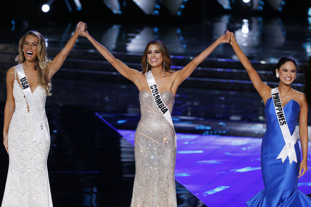 From left, Miss USA Olivia Jordan, Miss Colombia Ariadna Gutierrez and Miss Philippines Pia Alonzo Wurtzbach react as they make the final three at the Miss Universe pageant Sunday, December 20, 2015, in Las Vegas. (Photo by John Locher/AP Photo)