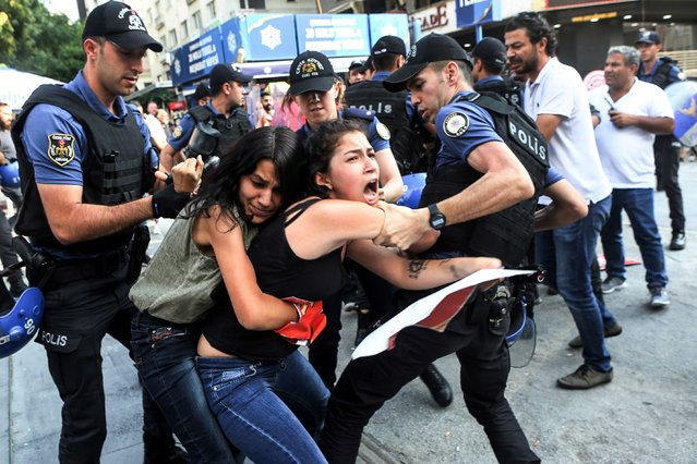 Turkish police officers arrest demonstrators, in Ankara, on July 20, 2018 as they were taking part in a protest rally for the anniversary of the 2015 suicide attack in the southern Turkish town of Suruc. Leftist youth gathered to protest as they mark the anniversary of a suicide bomb attacks which killed 31 people in Suruc where activists had gathered to prepare for an aid mission to the nearby Syrian town of Kobane. It was one of the deadliest attacks in Turkey in recent years and the first time the government has directly accused the Islamic State group of carrying out an act of terror on Turkish soil. (Photo by Adem Altan/AFP Photo)