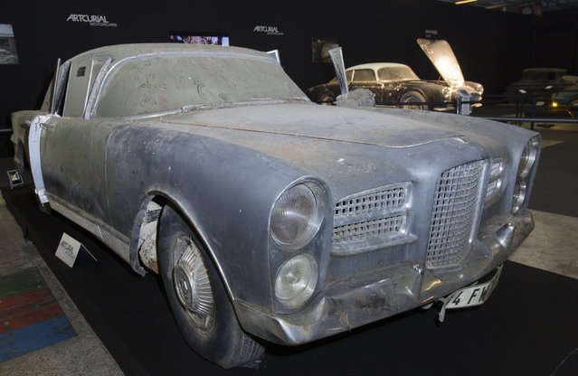 A Facel Vega Excellence car is displayed during a preview for an auction of vintage cars Retromobile show in Paris, Tuesday, February 3, 2015, after a treasure trove of classic cars was discovered after spending 50-years languishing in storage on a farm. (Photo by Jacques Brinon/AP Photo)