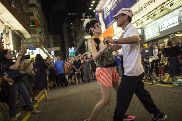 Buskers performing in Sai Yeung Choi Street South in Mongkok district, Hong Kong, China, 28 July 2018. (Photo by Jerome Favre/EPA/EFE)