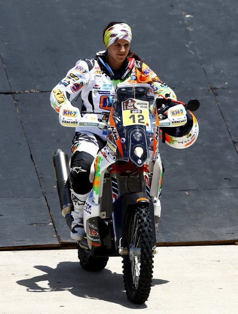 Laia Sanz of Spain rides her KTM from the podium during the departure ceremony of the 38th Dakar Rally in Buenos Aires, Argentina,  January 2, 2016. (Photo by Enrique Marcarian/Reuters)
