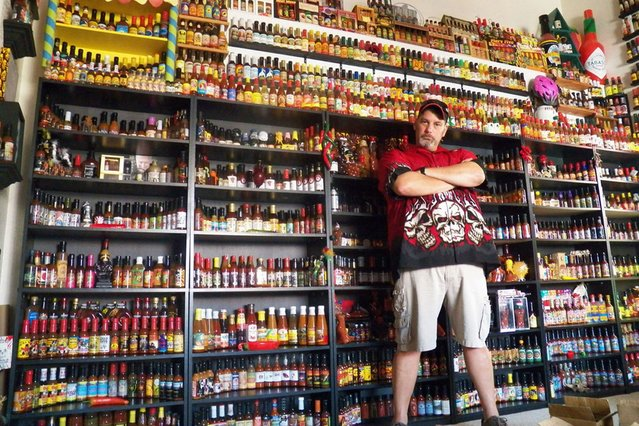 """Vic Clinco owns what is thought to be the world's largest hot sauce collection. His amazing 6,000 bottles collection from around the world includes a rare bottle of """"Blair's 16 Million Reserve"""", the hottest sauce on the planet. (Photo by Barcroft Media)"""