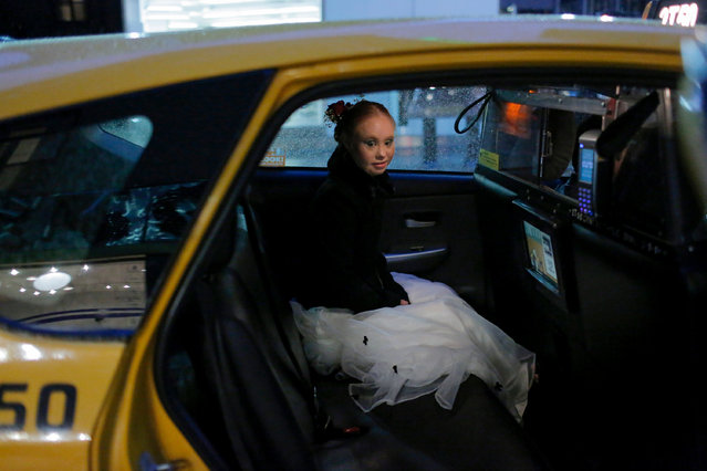 Model Madeline Stuart sits in the back of a taxi cab after walking in a runway show during New York Fashion Week in New York City, U.S., September 9, 2018. (Photo by Andrew Kelly/Reuters)