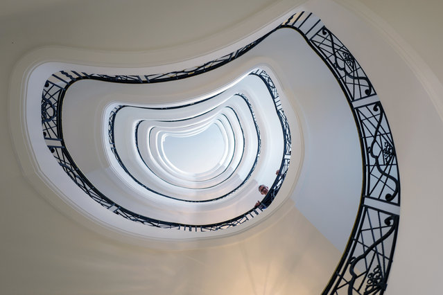 This picture taken on March 20, 2019 shows Louis, a concierge of the Hotel Martinez posing in the spiral staircase of the palace, on the French riviera city of Cannes, southern France. (Photo by Valery Hache/AFP Photo)
