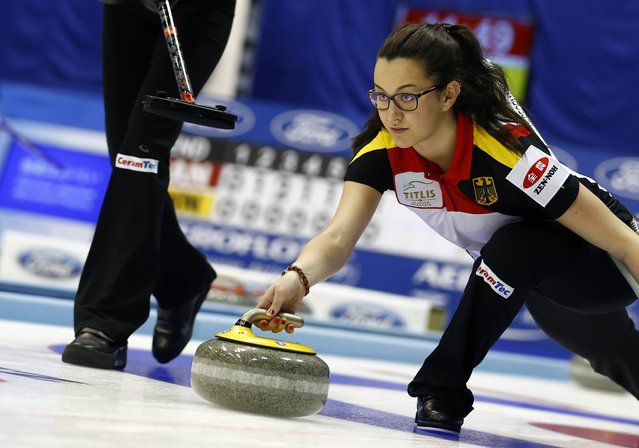 Germany's third Analena Jentsch delivers a stone during her curling round robin game against Finland during the World Women's Curling Championships in Sapporo March 16, 2015. (Photo by Thomas Peter/Reuters)