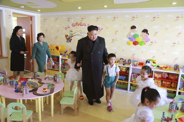 North Korean leader Kim Jong Un (C) visits the Pyongyang Baby Home and Orphanage on New Years Day in this photo released by North Korea's Korean Central News Agency (KCNA) in Pyongyang January 2, 2015. (Photo by Reuters/KCNA)