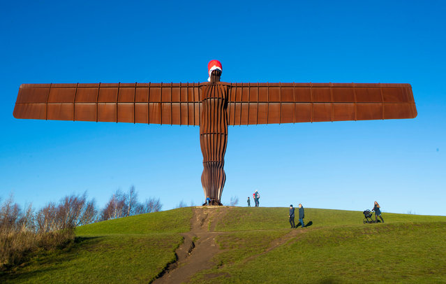 Angel of the North statue adorned with Sant Claus' hat is seen in Gateshead, Britain, December 24, 2018. (Photo by Danny Lawson/PA Wire Press Association)