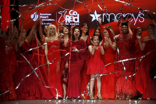 Participants cheer as streamers fall after presenting creations during the American Heart Association's (AHA) Go Red For Women Red Dress Collection, presented by Macy's at New York Fashion Week February 11, 2016. (Photo by Andrew Kelly/Reuters)