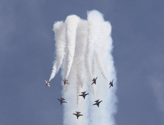 South Korea's Black Eagles aerobatics team perform a maneuver during a preview of the Singapore Airshow at Changi exhibition center in Singapore February 14, 2016. (Photo by Edgar Su/Reuters)