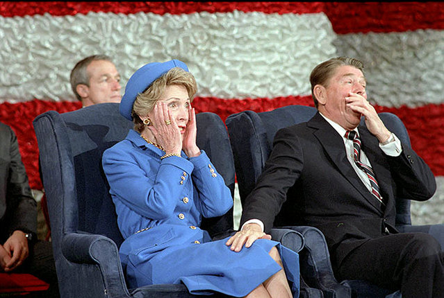 President Reagan laughs after Nancy forgot to introduce him during the Inaugural Band Concert in Washington, D.C., U.S. in January 1985. (Photo by Reuters/Ronald Reagan Presidential Library)