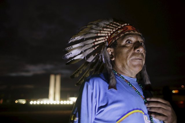 A Brazilian Indian from the Kaingang ethnic group attends the Terra Livre Camp (Free Land Camp) during a National Indigenous Mobilization at the Esplanade of Ministries in Brasilia April 14, 2015. Organizers of the mobilization aim to discuss issues of land demarcation and indigenous rights with authorities. (Photo by Ueslei Marcelino/Reuters)