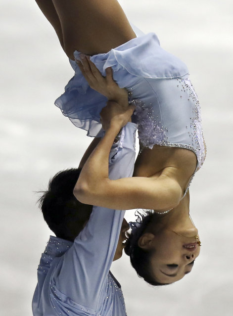 Sui Wenjing and Han Cong of China perform during the pairs free skate at the World Team Trophy Figure Skating Championships in Tokyo, Saturday, April 18, 2015. (Photo by Koji Sasahara/AP Photo)