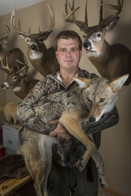 Rick Hanestad poses for a photograph with family pet Wiley. (Photo by Barcroft Media)