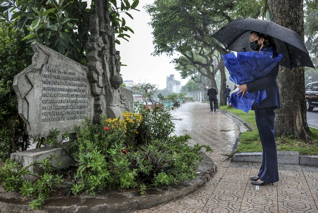 U.S. Vice President Kamala Harris lays flowers at the Senator John McCain memorial site, where his Navy aircraft was shot down by the North Vietnamese, on the three-year anniversary of his death, in Hanoi, Vietnam, Wednesday, August 25, 2021. (Photo by Evelyn Hockstein/Pool Photo via AP Photo)