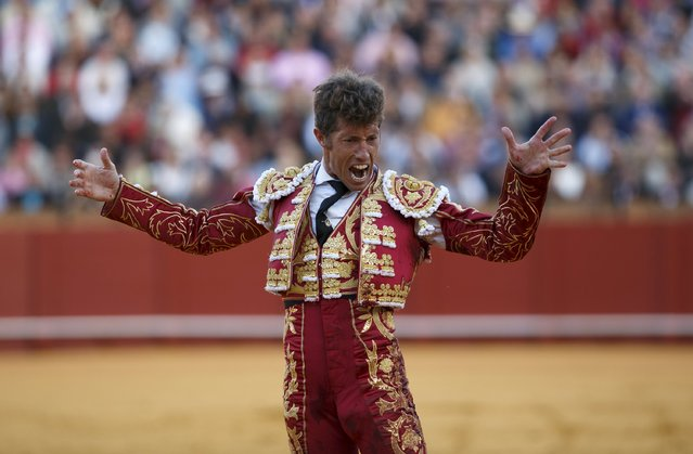 Spanish matador Manuel Escribano reacts after killing a bull during a bullfight at The Maestranza bullring in the Andalusian capital of Seville, southern Spain April 26, 2015. (Photo by Marcelo del Pozo/Reuters)
