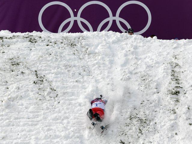 China's Liu Zhongqing crashes during freestyle skiing aerials training at the Rosa Khutor Extreme Park, at the 2014 Winter Olympics in Krasnaya Polyana, Russia, on February 10, 2014. (Photo by Andy Wong/Associated Press)