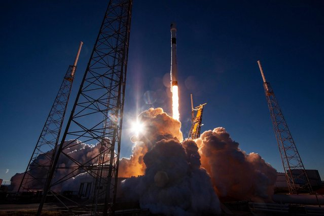 A handout photo made available by SpaceX shows the Falcon 9 reusable rocket at liftoff, while carrying the US Air Force's Global Positioning System III space vehicle into orbit, at the Space Launch Complex in Cape Canaveral, Florida, USA, 23 December 2018. The launch was the first national security mission for SpaceX, a private space transportation company founded by Elon Musk. (Photo by EPA/EFE/SpaceX)