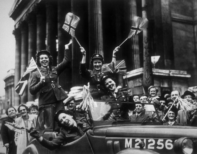 Soldiers from the Women's Royal Army Corps in their service vehicle, driving through Trafalgar Square during the VE Day celebrations in London. (Photo by R. J. Salmon/Getty Images)