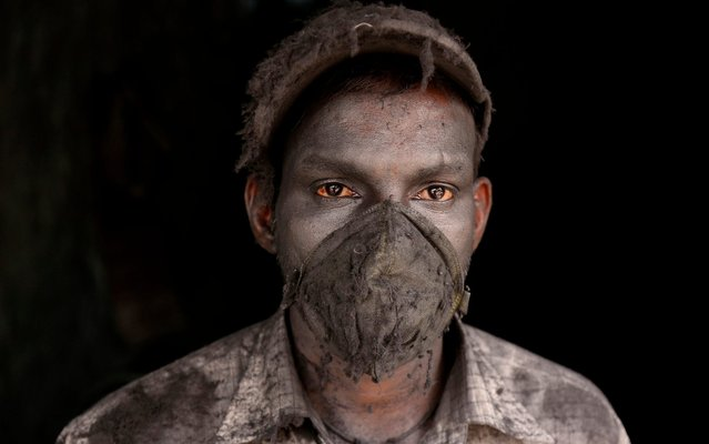 An Indian worker wears a worn out protection mask as he works in a small aluminum factory in Hyderabad, India, Tuesday, April 30, 2019. International Labor Day also known as May Day is marked across the world on May 1. (Photo by Mahesh Kumar A./AP Photo)