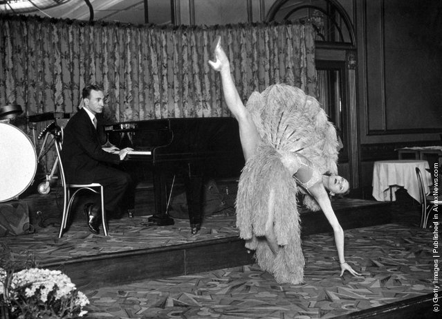 Pianist Jack Harris and dancer Vera run through a dress-rehearsal of a fan dance for the Dressmaker's Charity Ball