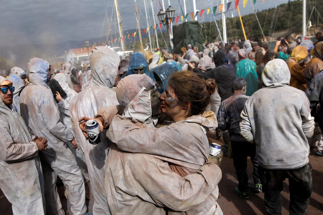 """Two revellers kiss as they celebrate """"Ash Monday"""" by participating in a colourful """"flour war"""", a traditional festivity marking the end of the carnival season and the start of the 40-day Lent period until the Orthodox Easter,in the port town of Galaxidi, Greece, February 27, 2017. (Photo by Alkis Konstantinidis/Reuters)"""