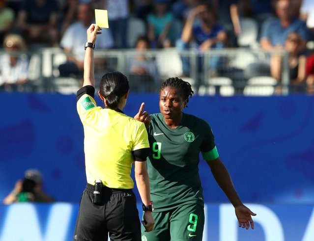 Referee Yoshimi Yamashita shows Desire Oparanozie of Nigeria a yellow card during the 2019 FIFA Women's World Cup France Round Of 16 match between Germany and Nigeria at Stade des Alpes on June 22, 2019 in Grenoble, France. (Photo by Denis Balibouse/Reuters)
