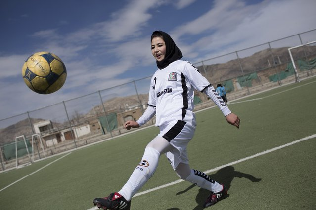 A female soccer player controls a ball during a training session at the Golab Trust Sport Complex in Kabul March 10, 2014. Despite decades of conflict in Afghanistan, and several recent militant attacks, the country's capital Kabul is home to a vibrant youth scene of musicians, artists, athletes and activists. Shopping malls and cafes stand in the city, which is nonetheless beset by infrastructure problems and instability. (Photo by Morteza Nikoubazl/Reuters)