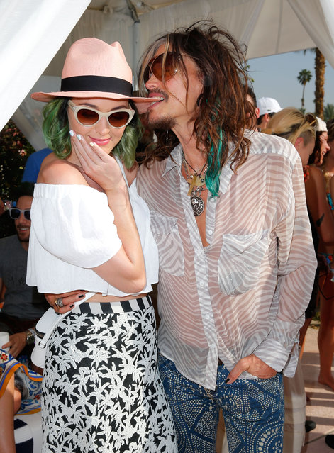 Singers Katy Perry (L) and Steven Tyler attend Day 1 of the LACOSTE Beautiful Desert Pool Party on April 12, 2014 in Thermal, California. (Photo by Joe Scarnici/Getty Images for LACOSTE)