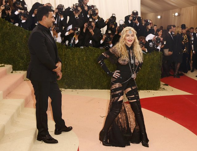 """Singer Madonna arrives with designer Riccardo Tisci at the Metropolitan Museum of Art Costume Institute Gala (Met Gala) to celebrate the opening of """"Manus x Machina: Fashion in an Age of Technology"""" in the Manhattan borough of New York, May 2, 2016. (Photo by Lucas Jackson/Reuters)"""