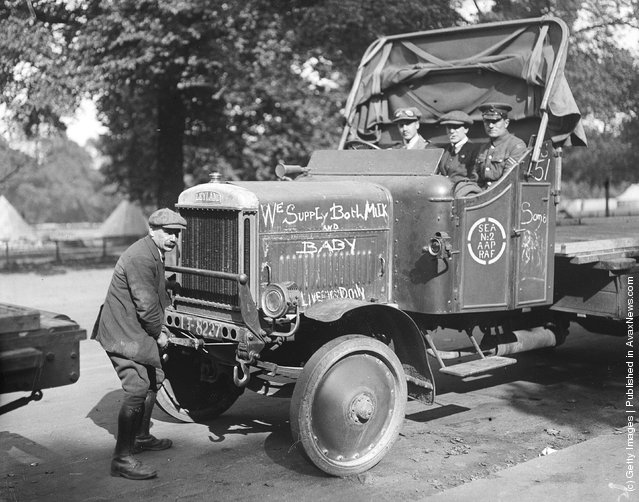 1919:  A Leyland lorry during the railway strike, 'we supply both milk and baby' is chalked on the bonnet