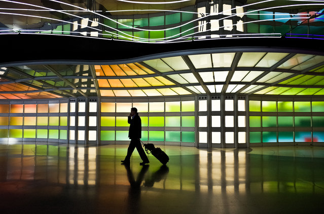 """""""Urban Traveler"""". A man is walking to the gate. Photo location: O'Hare International Airport, Chicago. (Photo and caption by Toru Tanaka/National Geographic Photo Contest)"""