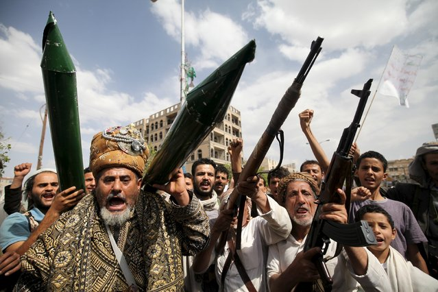 Houthi followers hold mock missiles and their rifles as they shout slogans during a demonstration against the United Nations in Sanaa, Yemen, July 5, 2015. (Photo by Mohamed al-Sayaghi/Reuters)