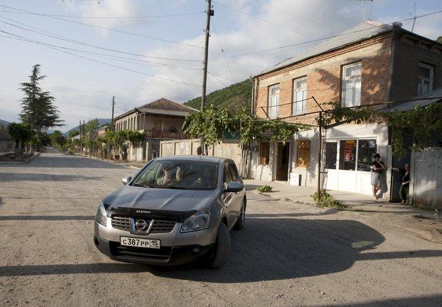 People drive a car in a street of Leningori (or Akhalgori), in the breakaway region of South Ossetia, Georgia, July 6, 2015. (Photo by Kazbek Basaev/Reuters)